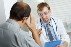 a doctor consulting with a patient about health symptoms